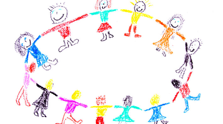 Child drawing of a colorful dancing children made with wax crayons
