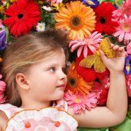 9385743 - little cute girl lying on the flower.